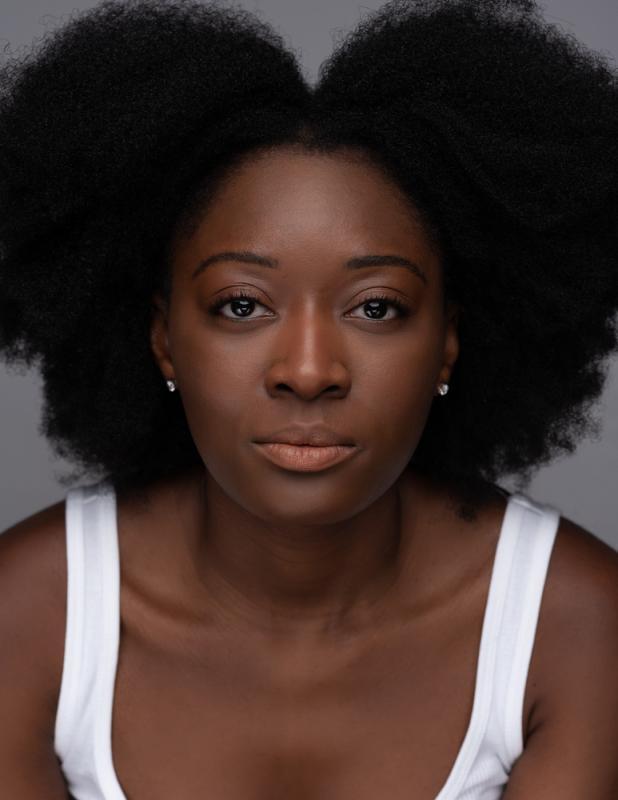 Ama afro headshot