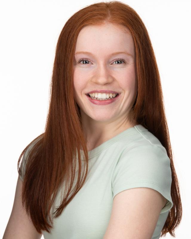 Zoey Deel Smile Headshot