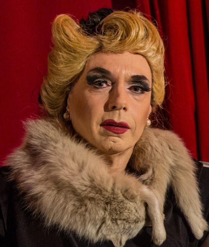 As Castruccio, a drag queen from 'Cover her face'