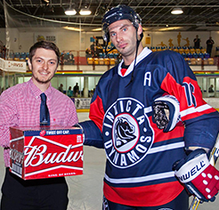 Courtney-Bues-Prestenting-Man-Off-The-Match-To-a-Ice-Hockey-Player