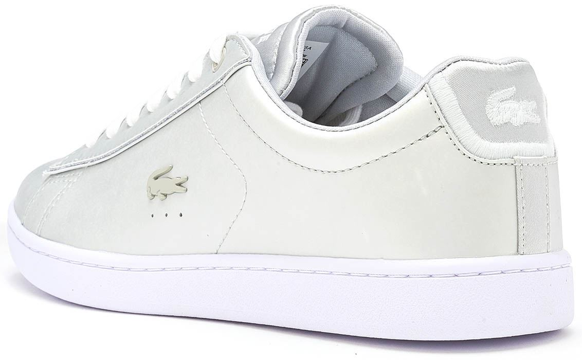 ee6f1bbd9 Description Classic Lacoste DNA runs throughout this tennis-inspired  cupsole executed in matte finish metallic synthetic leather.