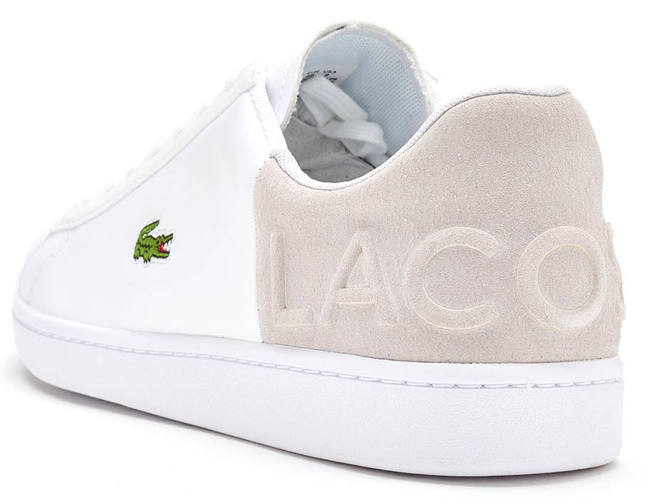 b18c4aa8abeac Description A timeless Lacoste court shoe presented in a classic colour  palette. Leather and suede uppers feature a new  Lacoste  embossed heel  pattern and ...