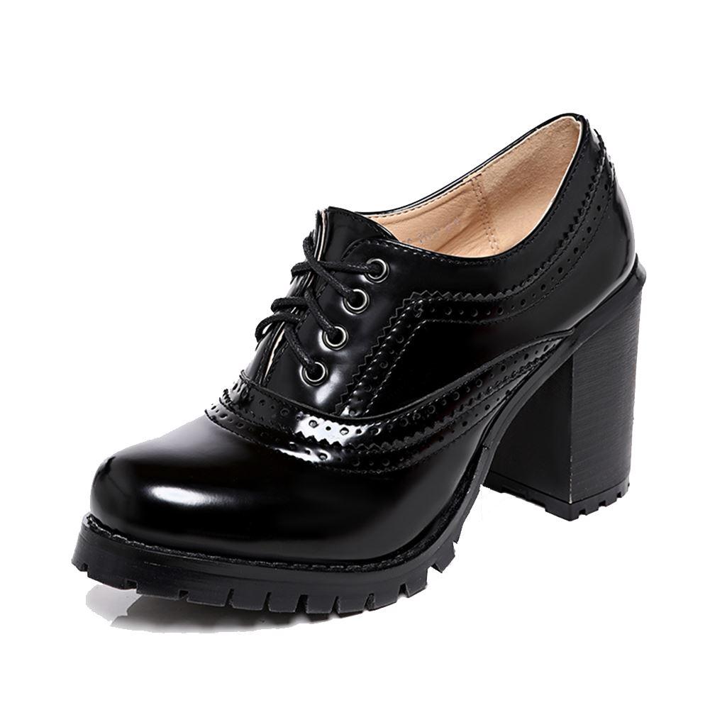 Brogue style block heel shoe boots