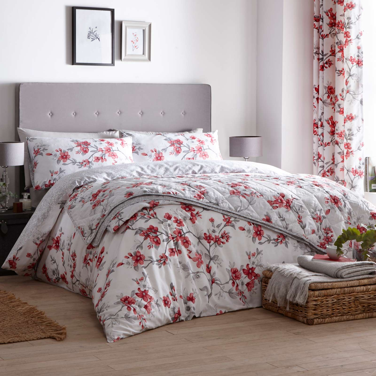 These suki duvet covers are available featuring an all over red mayflower pattern on a solid background the reverse of the bedding has