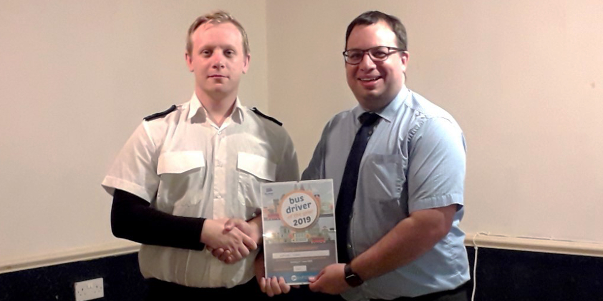 Photo of Bus Driver of the Year winner Alex Murray with Go South Coast Operations Director, David Lee-Kong