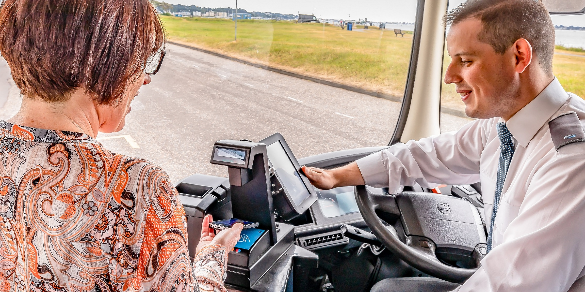 Photo of customer paying with the clickit2ride mobile app on-board a more bus