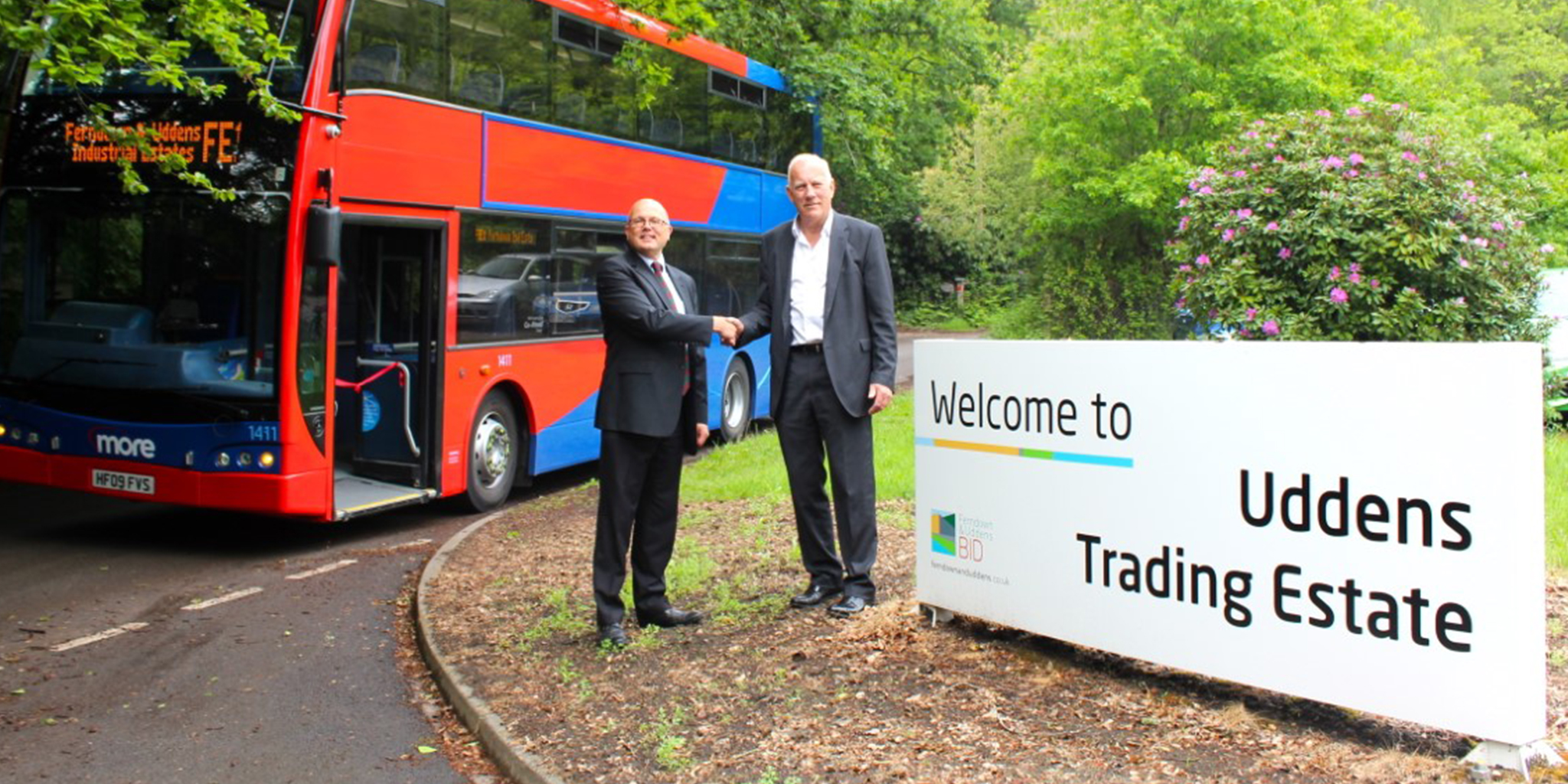 Picture of Andrew Wickham and Danny Godfrey in front of the FE1 Bus