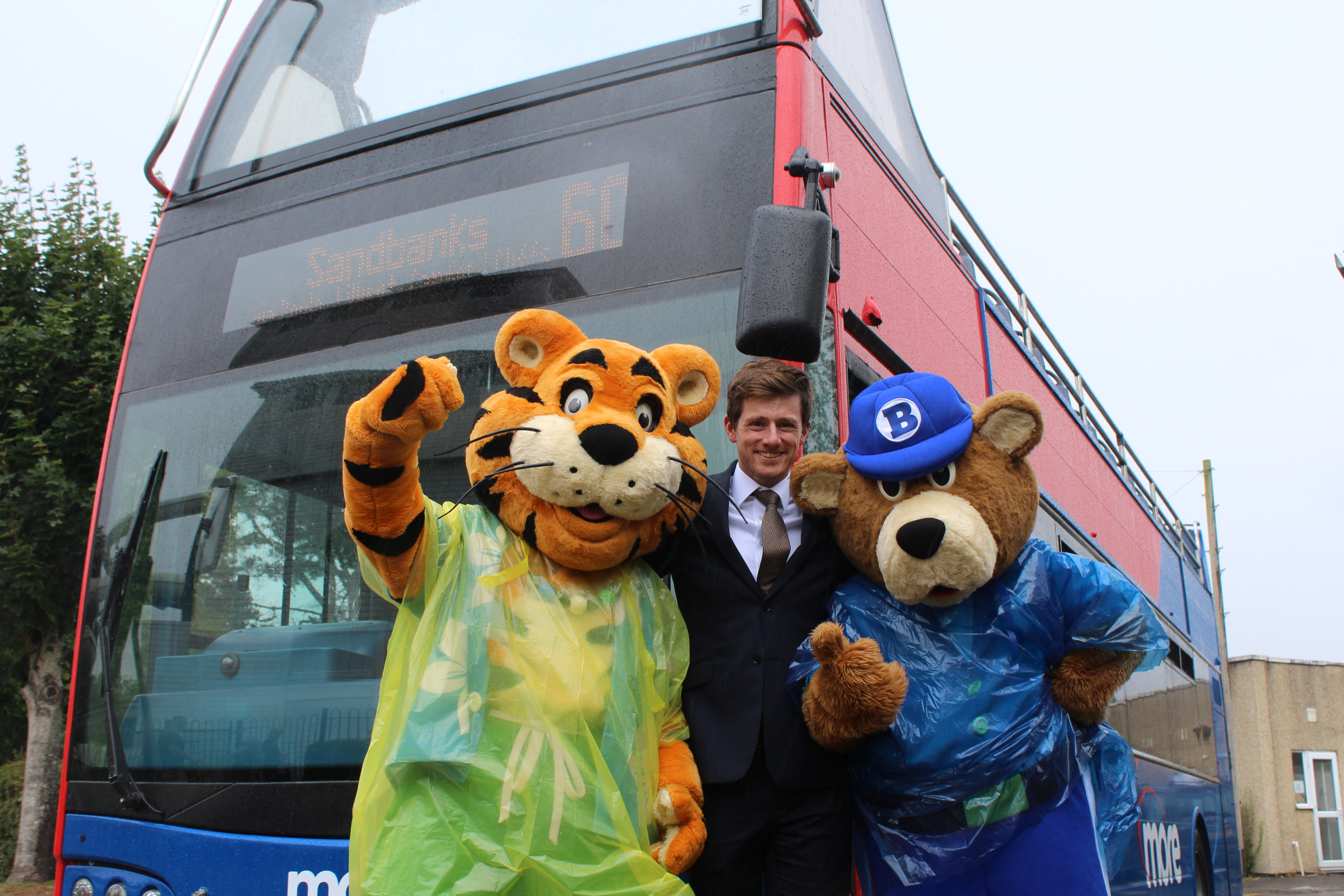 Photo of Rockley Park's Rory the Tiger and Bradley the Bear with morebus General Manager, David Heckles