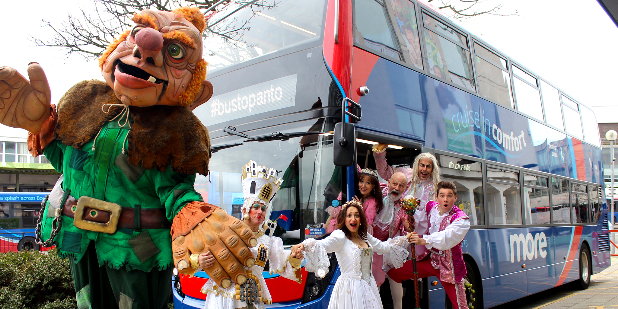 Photo of the cast of Jack and the Beanstalk cast in front of a morebus vehicle