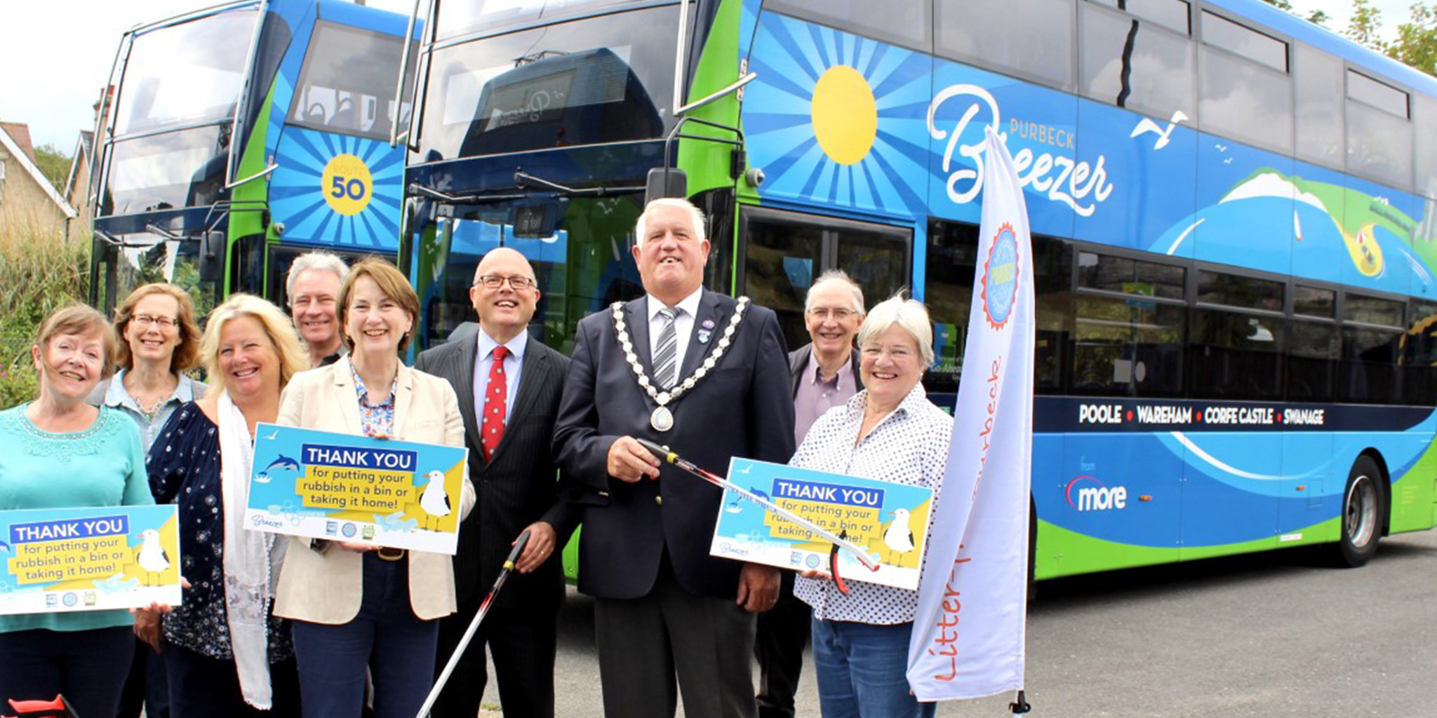 Photo of representatives from local councils and Litter-free Purbeck in front of a Purbeck Breezer bus