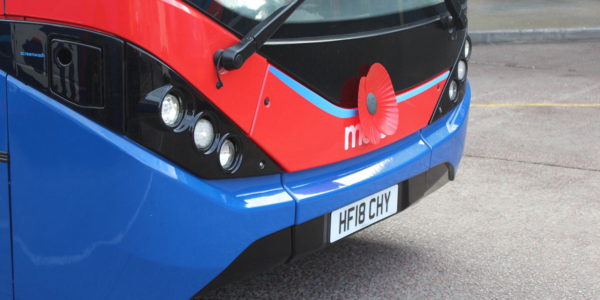 Photograph of a morebus sporting a remembrance poppy