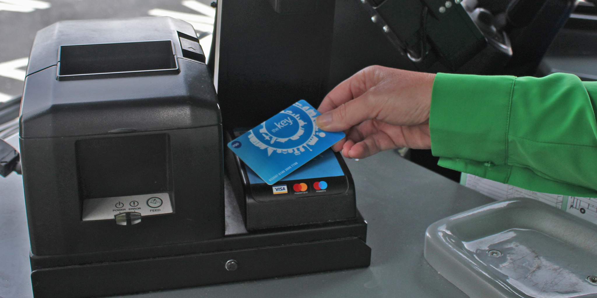 Photo of customer using theKey smart card on a more bus