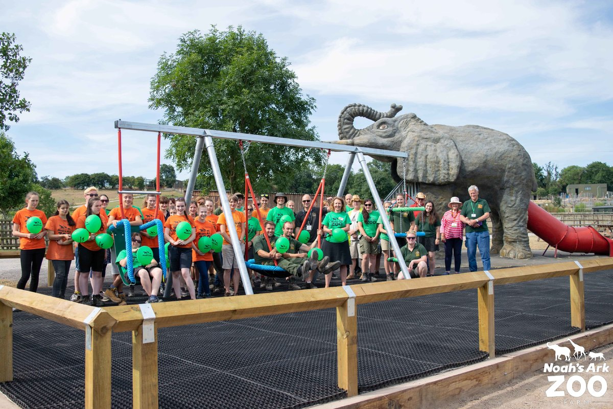 The zoo staff stand with their new accessible play equipment