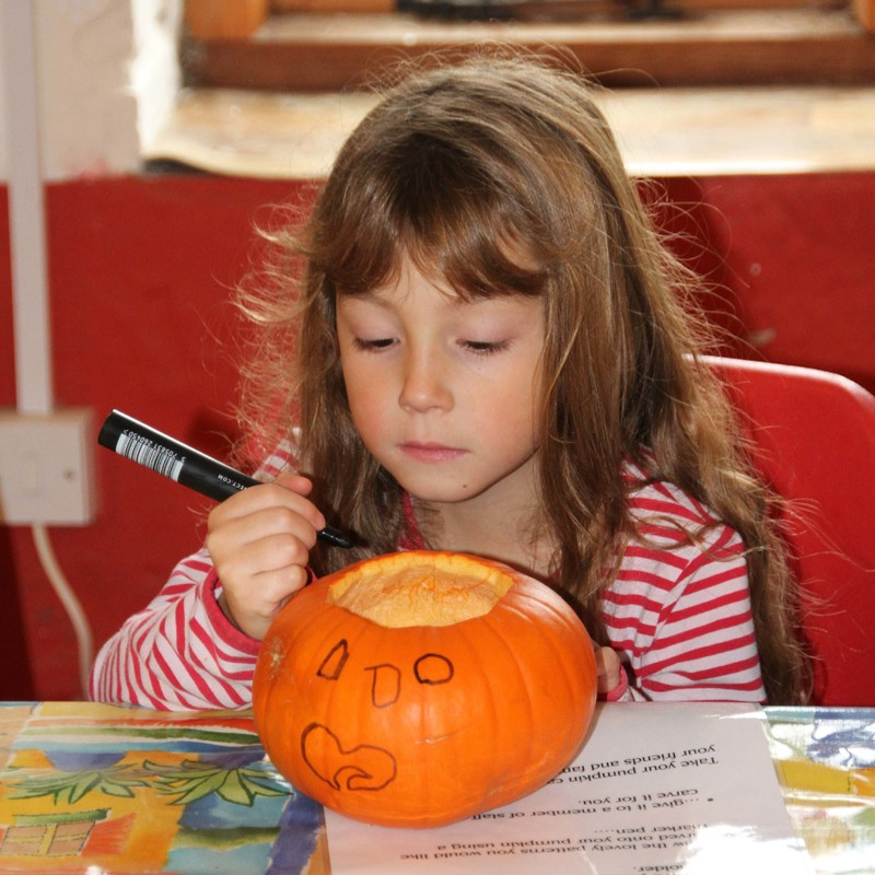 little girl Pumpkin carving