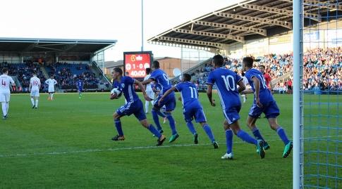 שחקני ישראל חוגגים את השוויון של לוגסי (ההתאחדות לכדורגל, איתן דותן)