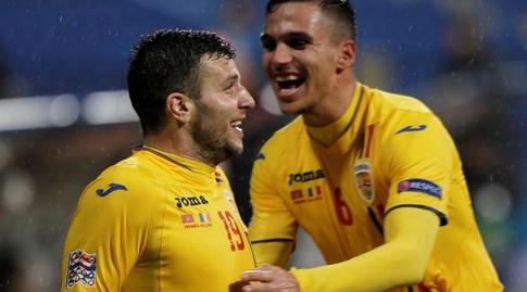 שחקני נבחרת רומניה חוגגים (רויטרס)