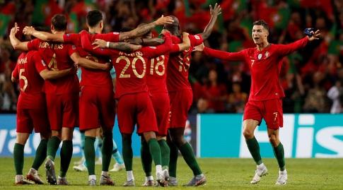 שחקני פורטוגל חוגגים בסיום (רויטרס)