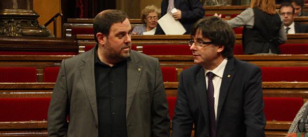 El president Carles Puigdemont i el vice-president Oriol Junqueras, en una sessió del parlament.