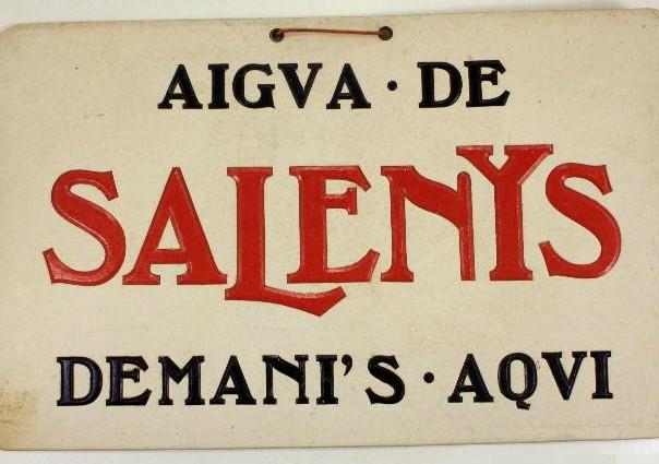 Placa publicitària metàl·lica de l'aigua de Salenys.