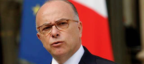 File photo of Interior Minster Bernard Cazeneuve who speaks in the courtyard of the Elyee Palace courtyard in Paris
