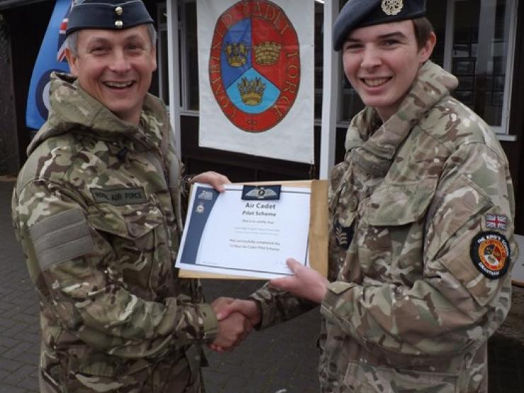 Flt Sgt Gibbs Being Officially Presented With His Air Cadet Pilot Scheme By Air Commodore Bentley At Our Recent Biannual Small
