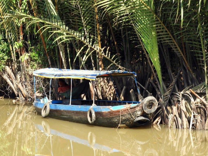 sleeping in a boat on the Mekong