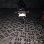 AX100 ( دباب ) دراجة نارية