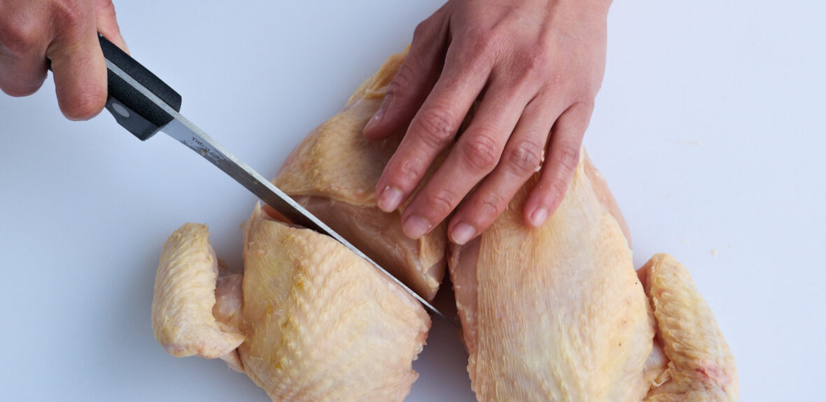 Joint a chicken into eight pieces