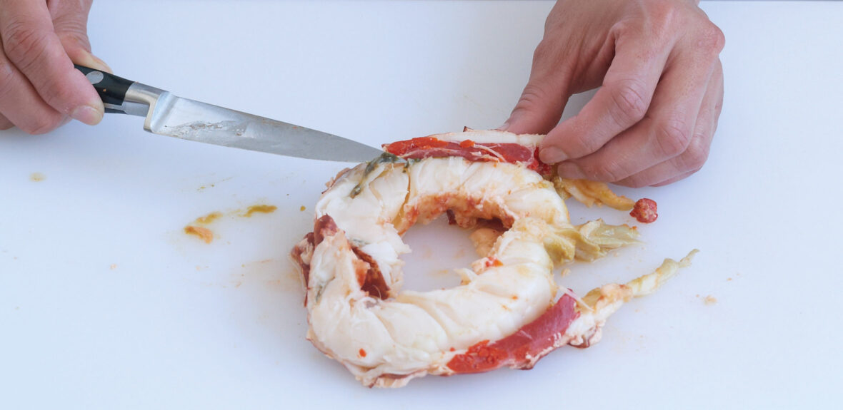 Remove the meat from a cooked whole lobster