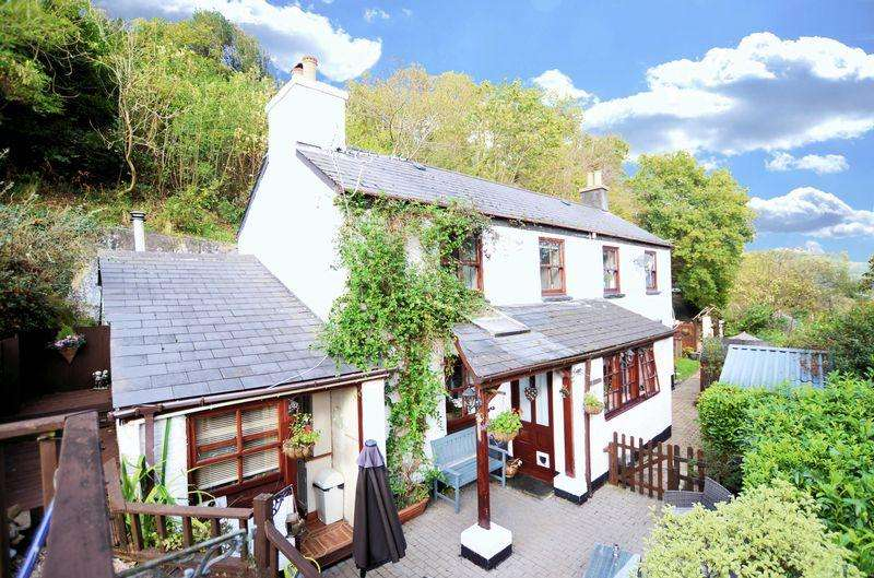 4 Bedrooms Detached House for sale in Spacious detached cottage with terraced garden valley views