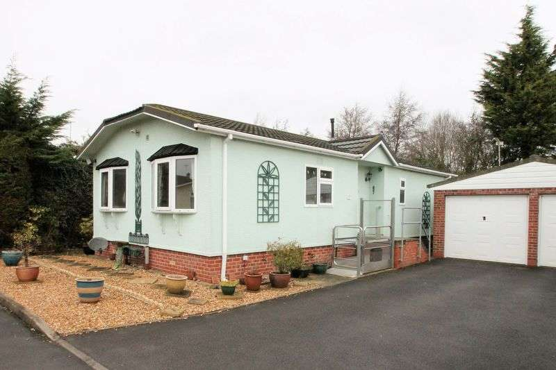 2 Bedrooms Detached Bungalow for sale in Wildwood Park, Cirencester, Gloucestershire.