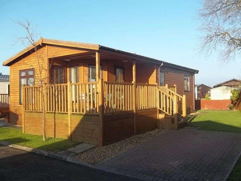 2 Bedrooms Bungalow for sale in 116 Flamingo Way, Willowgrove Park, Sandy Lane, Preesall, Poulton-Le-Fylde, Lancashire, FY6 0RB