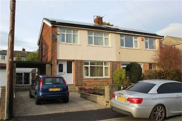 4 Bedrooms Semi Detached House for sale in Park House Walk, Low Moor, Bradford, West Yorkshire