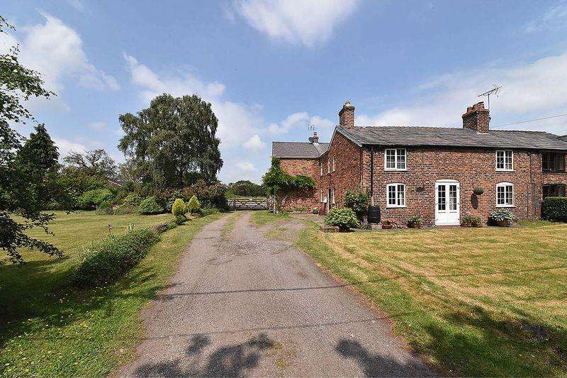 4 Bedrooms Semi Detached House for sale in Country cottage with stables and land