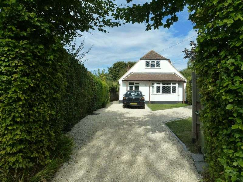 4 Bedrooms Detached House for sale in BOOKHAM - A MODERNISED 4 BEDROOM CHALET STYLE HOUSE IN SOUGHT AFTER ROAD