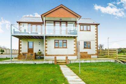 4 Bedrooms Detached House for sale in Plas Gwyn, Four Mile Bridge, Sir Ynys Mon, LL65