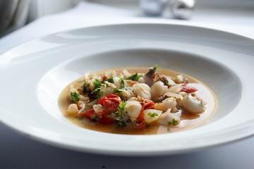 Rezept Baby Tintenfisch (Sepia) in Weißwein mit Cherry-Tomaten