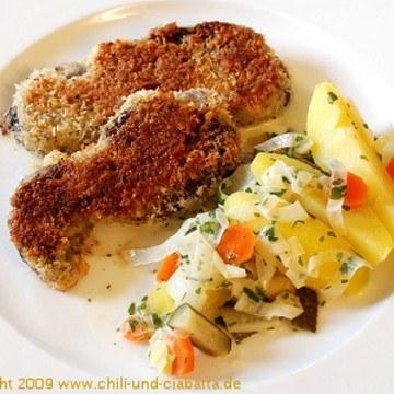Rezept Gebackene Rinderbackerl mit süß-saurem Kartoffel-Lauch-Gemüse