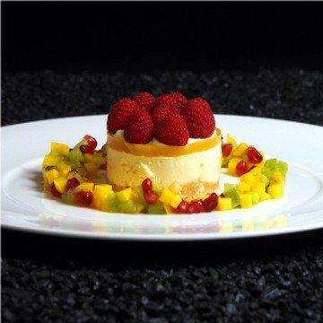 Rezept Passionsfruchttörtchen mit Obstsalat