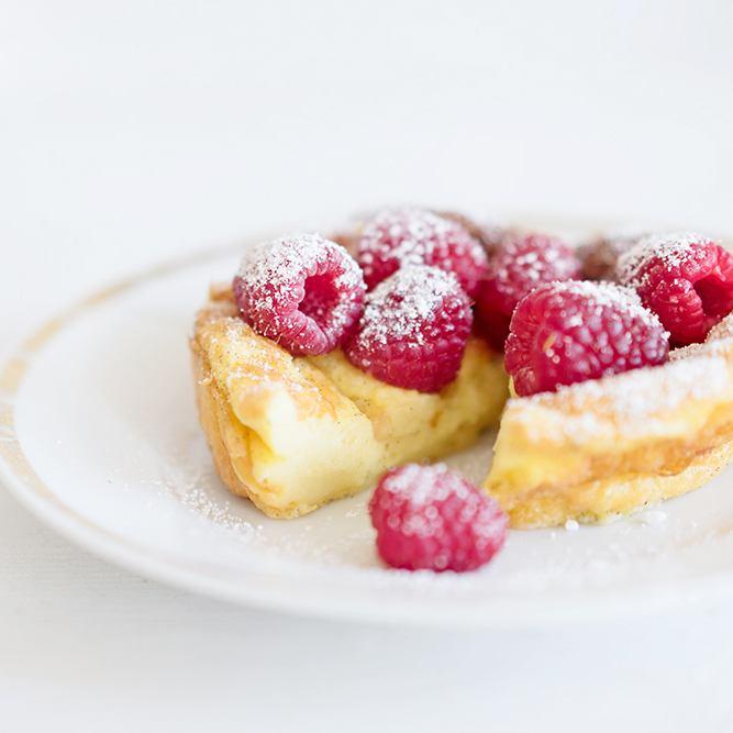Rezept Far Breton - Vanillepudding aus dem Ofen mit frischen Himbeeren