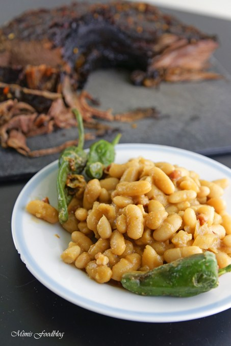 Rezept Texas BBQ Brisket aus dem Dutch Oven mit smoky Baked Beans ~ rustikales Outdoor Cooking
