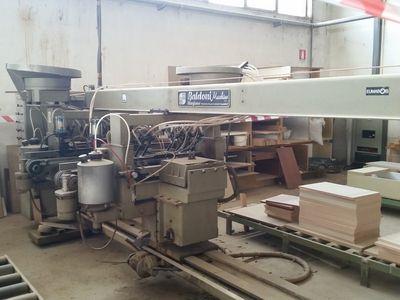 Inseritrice automatica Mola affilatrice e Spalmatrice - Asta 1065