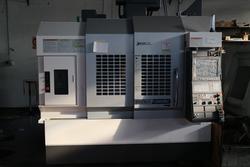 Centro di lavoro Okuma M560R-V - Lotto 1 (Asta 2463)