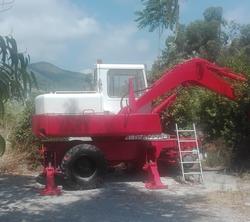 Escavatore gommato Poclain 60 - Lotto 5 (Asta 3575)