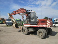 O K MH5 wheel excavator - Lot 8 (Auction 4419)