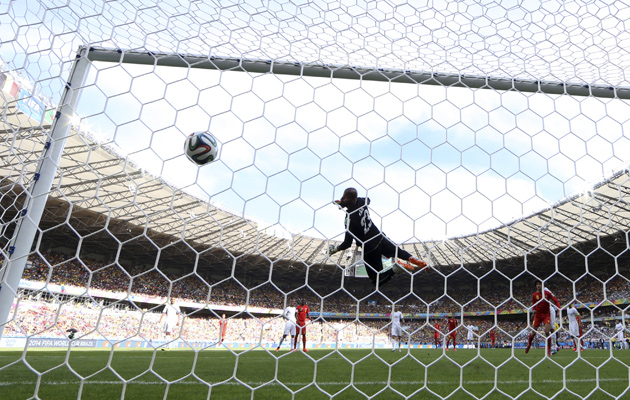 The view from behind the goal as Marouane Fellaini equalises for Belgium.