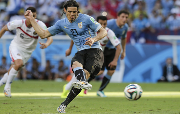 Edinson Cavani opens the scoring for Uruguay from the penalty spot.