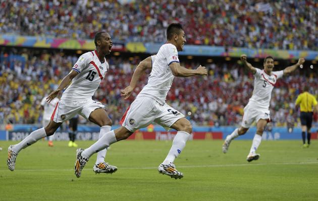 Costa Rica celebrate scoring against Uruguay.