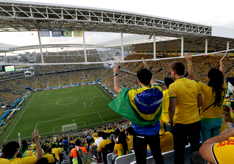Spectators watch the first half of the World Cup opening match between Brazil and Croatia at Itaquerao Stadium in Sao Paulo.