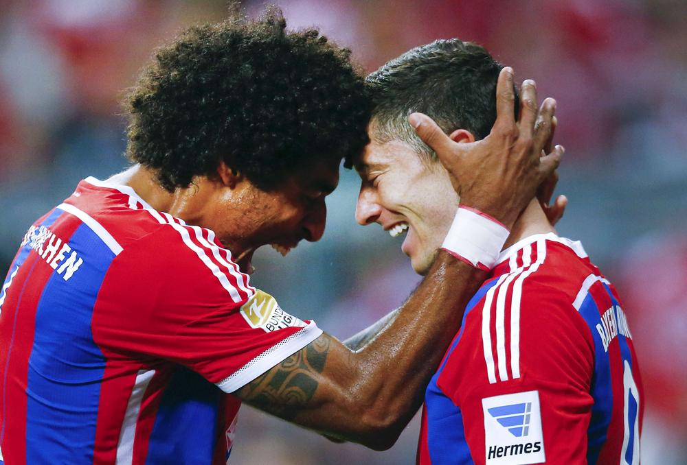 Bayern Munich's Lewandowski and Dante celebrate a goal against Paderborn during their German first division Bundesliga soccer match in Munich